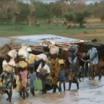 Women and children at the scene of the cyanide spill at Djibo dam