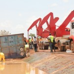 The cyanide containers being recovered from the water by heavy lifting equipment