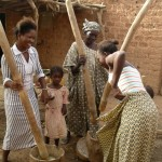 Fulani girls pounding millet
